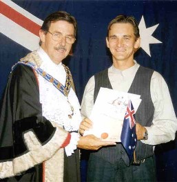 The Lord-Mayor of the Gold Coast hands me over the certificate of the Australian citizenship. The